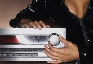 Woman in Shiny Black Bondage Gear Turning Up Volume bxp134857h